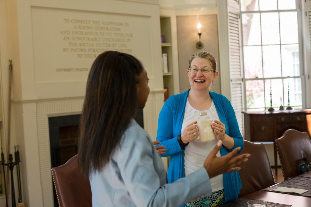 Michele Berger, Faculty Fellowship Program Director talks with a Fellow at Hyde Hall's Fellows Room.